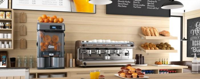 exprimidor de naranjas zumex versatile en un cafe